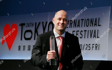 "Stock Picture of Lukas Moodysson Iceland's film director Benedikt Erlingsson smiles as he holds the trophy of the Best Director Award he won for his film ""Of Horses and Men"" during an awarding ceremony of the 26th Tokyo International Film Festival in Tokyo"