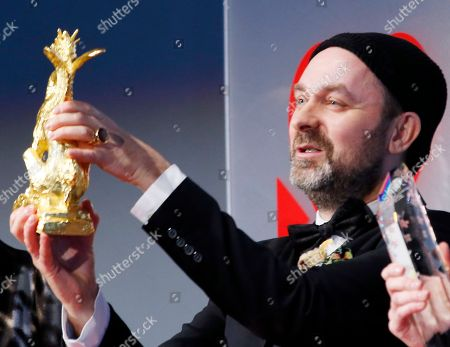 "Stock Photo of Lukas Moodysson Swedish film director Lukas Moodysson displays the trophy of Tokyo Sakura Grand Prix Award he won for his film ""We Are the Best!"" during an awarding ceremony of the 26th Tokyo International Film Festival in Tokyo"