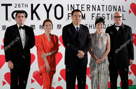 Stock Photo of Chris Weits, Moon So-ri, Chen Kaige, Shinogu Terajima, Chris Brown International Competition jury members, from left, American director and producer Chris Weits, South Korean actress Moon So-ri, Chinese director Chen Kaige, Japanese actress Shinobu Terajima and Australian producer Chris Brown, stand together upon their arrival on the green carpet for the opening ceremony of the 26th Tokyo International Film Festival in Tokyo