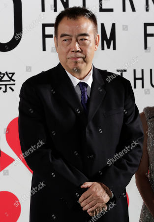 Chen Kaige Chinese director Chen Kaige poses upon his arrival on the green carpet for the opening ceremony of the 26th Tokyo International Film Festival in Tokyo