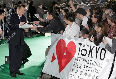 Chen Kaige Chinese director Chen Kaige gives his autograph to a fan on the green carpet upon his arrival for the opening ceremony of the 26th Tokyo International Film Festival in Tokyo