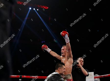 Evgeny Gradovich Russia's Evgeny Gradovich celebrates after defeating Australia's Billy Dib at their IBF featherweight title bout, in Macau. Gradovich retained the title when Dib quit in the ninth round