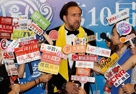 Nicholas Cage Actor Nicholas Cage speaks to broadcast journalists after winning the Best Global Actor in Motion Pictures award at the 10th Huading Awards ceremony in Macau