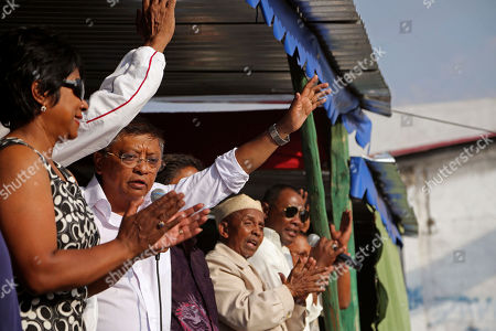 Madagascar presidential candidate Robinson Jean Louis, second left, speak at a rally in Antananarivo, Madagascar, . Residents of the island nation of Madagascar voted Friday in a presidential election they hope will restore security, improve lives and mark the end of political and economic turmoil brought about by a 2009 coup