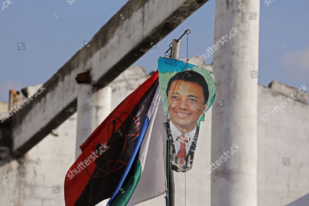 Stock Image of A photo depicting ousted Madagascar president Marc Ravalomanana hangs on a wire during a rally by presidential candidate Robinson Jean Louis in Antananarivo, Madagascar, . Residents of the island nation of Madagascar voted Friday in a presidential election they hope will restore security, improve lives and mark the end of political and economic turmoil brought about by a 2009 coup
