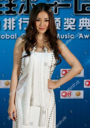 Kay Tse Hong Kong singer Kay Tse poses for photographers on the red carpet at the 13th Global Chinese Music Awards in Kuala Lumpur, Malaysia