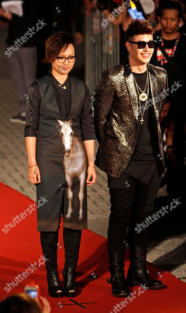 Stock Image of Zhou Bichang, Will Pan Chinese singer Zhou Bichang, left, and Taiwanese singer Will Pan pose for photographers on the red carpet at the 13th Global Chinese Music Awards in Kuala Lumpur, Malaysia