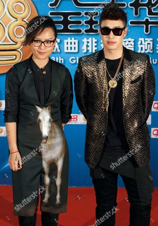 Zhou Bichang, Wilber Pan Chinese singer Zhou Bichang, left, and Taiwanese singer Wilber Pan pose for photographers on the red carpet at the 13th Global Chinese Music Awards in Kuala Lumpur, Malaysia