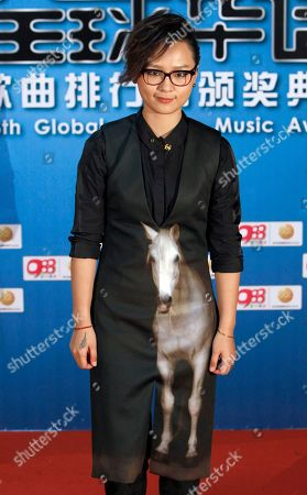 Zhou Bichang Chinese singer Zhou Bichang poses for photographers on the red carpet at the 13th Global Chinese Music Awards in Kuala Lumpur, Malaysia