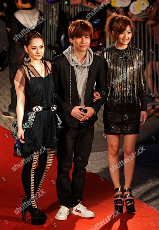 Gillian Chung, Adason Lo, Charlene Choi Hong Kong singers Gillian Chung, left, Adason Lo, center, and Charlene Choi pose for photographers on the red carpet at the 13th Global Chinese Music Awards in Kuala Lumpur, Malaysia