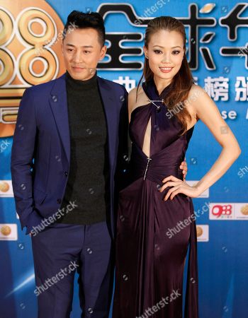 Raymond Lam, Joey Yung Hong Kong singers Raymond Lam, left, and Joey Yung pose for photographers on the red carpet at the 13th Global Chinese Music Awards in Kuala Lumpur, Malaysia