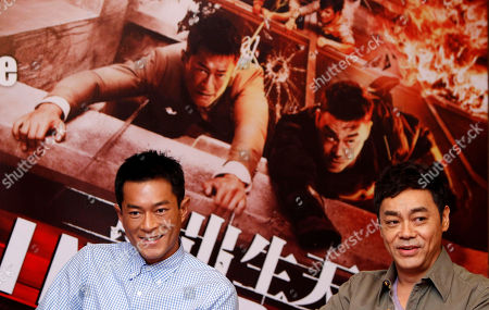 "Sean Lau, Louis Koo Hong Kong actors Sean Lau, right, and Louis Koo smile during a press conference to promote their latest film ""Inferno"" in Petaling Jaya, near Kuala Lumpur, Malaysia"