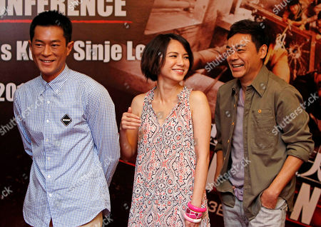 "Sean Lau, Louis Koo, Angelica Lee Hong Kong actors Sean Lau, right, Louis Koo, left, and Malaysian actress Angelica Lee laugh as they pose for photographers during a press conference to promote their latest film ""Inferno"" in Petaling Jaya, near Kuala Lumpur, Malaysia"