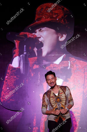 """Jacky Cheung Hong Kong singer Jacky Cheung poses for photographers during a press conference on his concert album """"1/2 Century Tour"""" in Kuala Lumpur, Malaysia"""