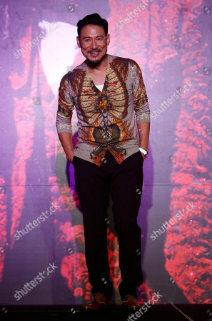 """Jacky Cheung Hong Kong singer Jacky Cheung poses for photographers during a press conference of his concert album """"1/2 Century Tour"""" in Kuala Lumpur, Malaysia"""