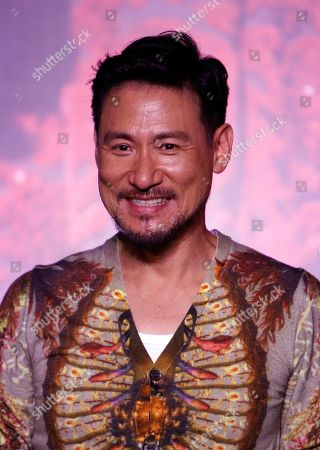 """Jacky Cheung Hong Kong singer Jacky Cheung smiles as he poses for photographers during a press conference of his concert album """"1/2 Century Tour"""" in Kuala Lumpur, Malaysia"""