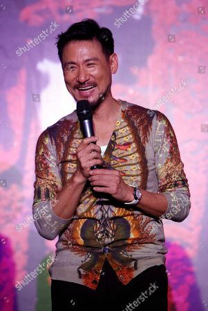 """Jacky Cheung Hong Kong singer Jacky Cheung smiles during a press conference of his concert album """"1/2 Century Tour"""" in Kuala Lumpur, Malaysia"""