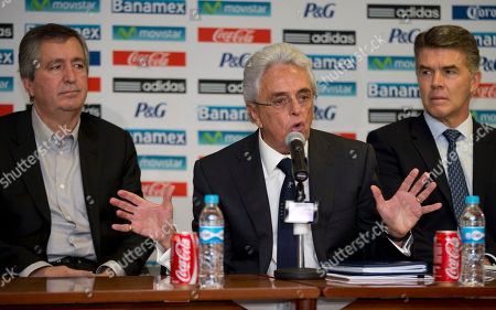 Jorge Vergara, Justino Compean, Hector Gonzalez Mexico's Chivas President Jorge Vergara, left, Mexican Soccer Federation President Justino Compean, center, and Hector Gonzalez, the director of Mexico's national soccer teams, give a press conference in Mexico City, . Mexican federation officials announced that Miguel Herrera was hired as the new Mexico coach for playoff games next month against New Zealand, with the winning team advancing to next year's World Cup in Brazil