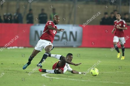 Egypt player Shikabala and Ghana's Wakaso Mubarak fight for the ball at their World Cup qualifying playoff second leg soccer match, at the Air Defense Stadium in Cairo, Egypt, . Ghana qualified for the World Cup on Tuesday with a 7-3 aggregate win over Egypt in the playoffs to seize the fourth of five African places available at the finals