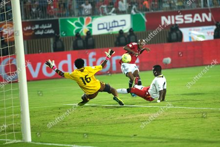 Egypt player Shikabala tries to beat Ghana's goalkeeper Fatau Duda at their World Cup qualifying playoff second leg soccer match, at the Air Defense Stadium in Cairo, Egypt, . Ghana qualified for the World Cup on Tuesday with a 7-3 aggregate win over Egypt in the playoffs to seize the fourth of five African places available at the finals