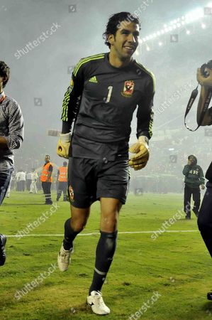 Egyptian Al Ahly club player Sherif Ekramy Ahmed celebrates after winning South Africa's Orlando Pirates, at the Arab Contractors stadium in Cairo, Egypt, . Egypt's Al Ahly retained its African Champions League title by beating South Africa's Orlando Pirates 2-0 on Sunday, with the match being played amid heavy security and preceded by clashes between fans and police outside the stadium in Cairo