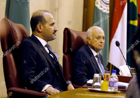 Ahmad Jarba, the head the opposition Syrian National Coalition, left, and Arab League General Secretary Nabil Elaraby, chair the Arab foreign ministers meeting at the league's headquarters in Cairo, Egypt, . Foreign ministers from the League's member states meet to discuss the 2 1/2-year Syrian crisis and the peace talks expected to take place later this month