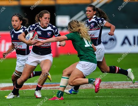 Megan Lee Bonny of the U.S. drives against Ireland during the first day of the Women's Sevens World Series in Dubai, United Arab Emirates