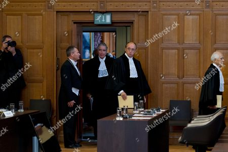 Hisashi Owada, Peter Tomka, Bernardo Sepulveda Amor Court President Peter Tomka of Slovakia, second from right, judge Hisashi Owada of Japan, right, and Vice President Bernardo Sepulveda Amor of Mexico, center in doorway, enter the World Court in The Hague, Netherlands, . The United Nations' highest court was issuing its ruling Monday on a dispute between Cambodia and Thailand over land surrounding a 1,000-year-old temple near the Southeast Asian neighbors' border