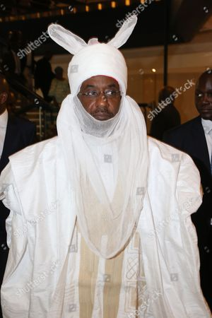 "Former Nigeria central bank governor Lamido Sanusi, attends an event in Abuja, Nigeria. A friend and former Cabinet minister says State Security agents seized the passport of ousted Central Bank governor Lamido Sanusi and plan to arrest him on trumped up charges. Nasir El Rufai told the AP Friday that Sanusi's lawyers are filing suit for alleged breach of human rights and threats of arrest and malicious prosecution. President Goodluck Jonathan on Thursday ousted the internationally respected Sanusi, accusing him of ""financial recklessness."" Critics say it is because Sanusi exposed some $20 billion in missing petrodollars"