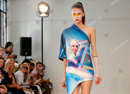 Stock Image of A model presents a creation by fashion designers Eri and Philip Chu, from Hong Kong, for Ground Zero's ready-to-wear Spring/Summer 2014 fashion collection, presented in Paris, Tuesday, Sept.24, 2013