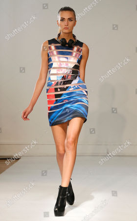 Stock Picture of A model presents a creation by fashion designers Eri and Philip Chu, from Hong Kong, for Ground Zero's ready-to-wear Spring/Summer 2014 fashion collection, presented in Paris, Tuesday, Sept.24, 2013