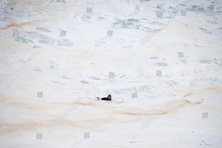 Brazilian surfer Maya Gabeira floats in whitewater after falling trying to ride a big wave at the Praia do Norte, north beach, at the fishing village of Nazare in Portugal's Atlantic coast . Gabeira who nearly drowned was rescued unconscious and taken to hospital where she is reportedly doing well despite suffering a broken ankle