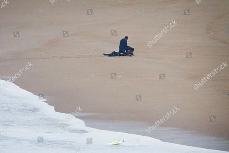 Surfers apply CPR to fellow surfer Maya Gabeira, from Brazil who nearly drowned after falling trying to ride a big wave at the Praia do Norte, north beach, at the fishing village of Nazare in Portugal's Atlantic coast . Gabeira was taken to hospital and is reportedly doing well despite suffering a broken ankle