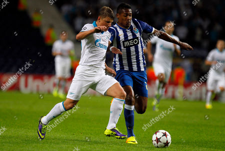 Stock Photo of Zenit's Andrey Arshavin, left, vies for the ball with Porto's Alex Sandro, from Brazil, during the Champions League group G soccer match between FC Porto and Zenit at the Dragao stadium in Porto, northern Portugal
