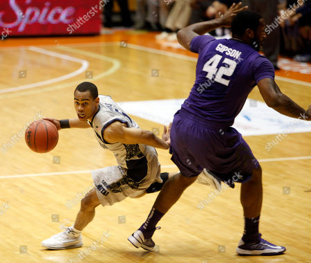 Markel Starks, Thomas Gibson Georgetown guard Markel Starks, left, drives the ball past Kansas State forward Thomas Gibson during an NCAA college basketball game in San Juan, Puerto Rico