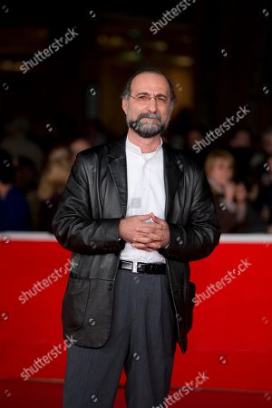 Tayfun Pirselimoglu Director Tayfun Pirselimoglu poses on the red carpet as he arrives for the screening of the movie 'Ben o Degilim' (I'm Not him) at the 8th edition of the Rome International Film Festival in Rome