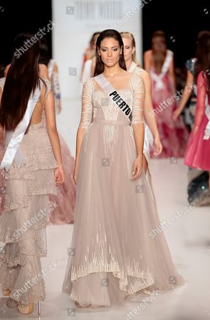 Monic Perez Contestant of the Miss Universe pageant, Miss Puerto Rico Monic Perez shows creation by British designer Tony Ward at the Fashion Week in Moscow, . Beauties will compete for the title of Miss Universe in Moscow on Nov. 9