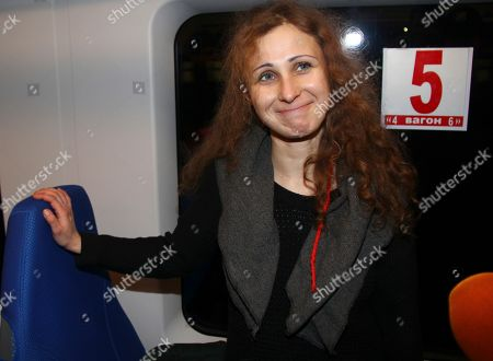 Stock Image of Maria Alekhina Maria Alekhina, a member of the Russian punk band Pussy Riot takes a seat in the train from Nizhny Novgorod to Moscow after being released from prison, in Nizhny Novgorod, . Alekhina, and two other band members, Nadezhda Tolokonnikova and Yekaterina Samutsevich, were found guilty of hooliganism motivated by religious hatred and sentenced to two years in prison for the performance at Moscow's main cathedral in March 2012. Samutsevich was released several months later on suspended sentence
