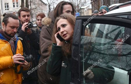Stock Picture of Maria Alekhina Maria Alekhina, second left, a member of the Russian punk band Pussy Riot speaks on the phone after being released from prison, in Nizhny Novgorod, . Alekhina, and two other band members, Nadezhda Tolokonnikova and Yekaterina Samutsevich, were found guilty of hooliganism motivated by religious hatred and sentenced to two years in prison for the performance at Moscow's main cathedral in March 2012. Samutsevich was released several months later on suspended sentence