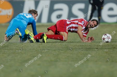 Andrey Arshavin, Raul Garcia Zenit's Andrey Arshavin, left, fouls on Atletico's Raul Garcia during the Champions League group G soccer match between Zenit and Atletico Madrid at Petrovsky stadium in St.Petersburg, Russia, on