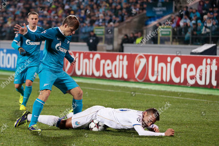 Porto's Nicolas Otamendi lies on the floor and the ball after a challenge from Zenit's Andrei Arshavin during the Champions League group G soccer match between Zenit and Porto at Petrovsky stadium in St.Petersburg, Russia, on