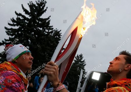 Kostya Tszyu, Dima Bilan Russian boxer Kostya Tszyu, left, and Russian pop singer Dima Bilan hold Olympic torches during a relay in Moscow, Russia, . Moscow's Kremlin is at the background. The relay for the Sochi Winter Games, which began Monday in Moscow, will pass through many cities that showcase the historical, cultural and ethnic richness of Russia