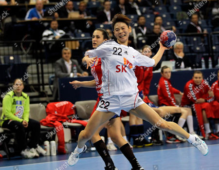 South Korea's Sun Hee Woo, foreground tries to score as Serbia's Andrea Lekic defends during their eighth final round match at the Women's Handball World Championship, in Belgrade, Serbia