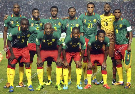 Stock Image of Cameroon soccer team poses prior to the start the World Cup qualifying soccer between Tunisia and Cameroon in Tunis, Tunisia. Foreground from left: Tchounko Nounke, Kouamo Webo, Takang Enouh Eyong and Jean Makoun. Background from left: Allan Romeo Nyom, Bilong Song, Ndoubena Nkoulou, Fongang Chedjou, Job Mtip Joel and Samuel Etoo