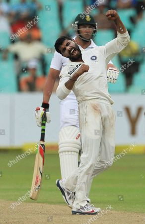 India's bowler Ravindra Jadeja, front, celebrates taking the wicket as South Africa's batsman Jacques Kallis, watches on the third day of their cricket test match against South Africa at Kingsmead stadium, Durban, South Africa