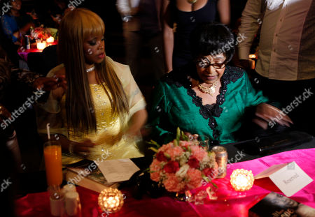 "Zoleka Mandela, Winnie Madikizela-Mandela Author Zoleka Mandela, left, granddaughter of former president Nelson Mandela, and Winnie Madikizela-Mandela, right, Nelson Mandela's former wife, attends the launch of Zoleka's book ""When Hope Whispers,"" in Johannesburg . The book recounts her struggles with alcohol and drug addiction, losing two of her children and fighting breast cancer"