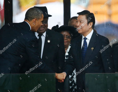 Namibia's President Hifikepunye Pohamba, center, watches as President Barack Obama shakes hands with China's Vice President Li Yuanchao during the memorial service for former South African president Nelson Mandela at the FNB Stadium in Soweto near Johannesburg