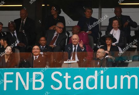 Former South African president FW De Klerk sits in the stands during the memorial service for former South African president Nelson Mandela at the FNB Stadium in Soweto near Johannesburg