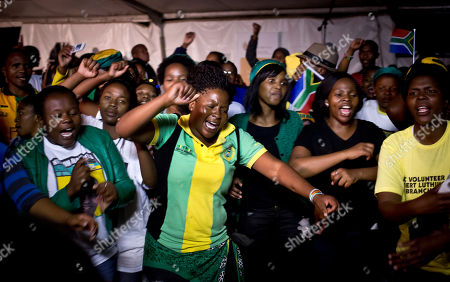 Youth members of the African National Congress (ANC) dance, pray and sing songs honoring Nelson Mandela, at a nighttime vigil at the Walter Sisulu University in Mthatha, South Africa, . ANC members, party leaders, and government officials gathered for the traditional night vigil to honor Mandela on the eve of his burial