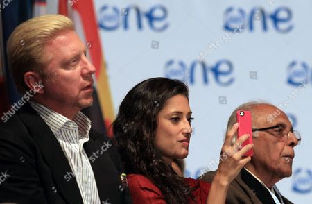 Fatima Bhutto, Pakistani poet and writer, center, with German former tennis player Boris Becker, left, and former Robben Island prisoner, Achmat Kathrada, right, during the opening ceremony for the One Young World summit at Soccer City in Johannesburg, South Africa, . Kathrada, was sentenced to life imprisonment with Nelson Mandela. The world's biggest youth summit kicks off in Johannesburg today with former United Nations Secretary-General Kofi Annan, businessman Sir Richard Branson and activist Sir Bob Geldof descending on Johannesburg to facilitate discussions